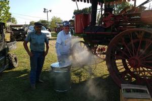 Two seasoned cooks watching the STEAM lift the lid slightly.