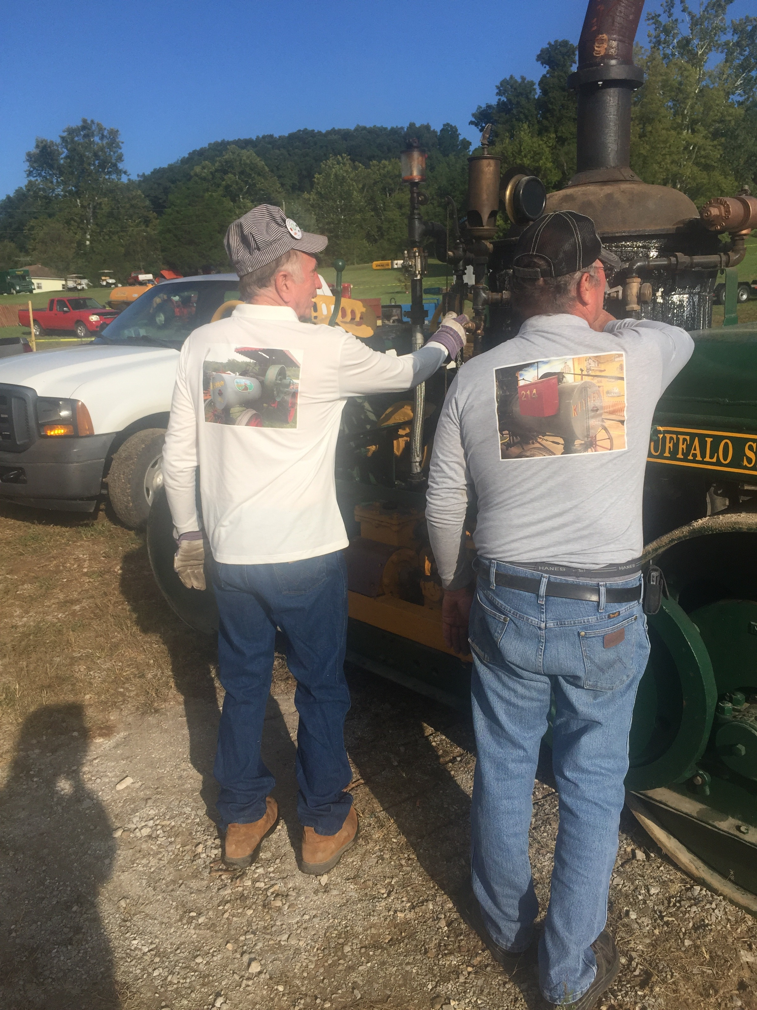 Jerry Kitten and Mike Lindauer showing their new T-shirts that have Mike's photo of his engine.
